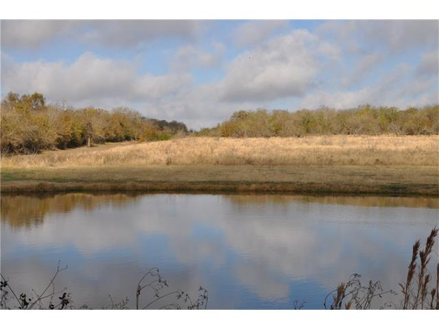26 +/- acres of gently rolling, partially wooded, partially fenced farm land with small pond. Ideal for hunting, livestock, recreational fishing.