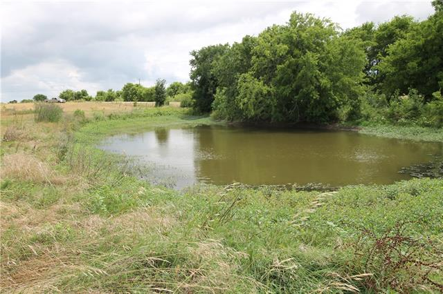 Own a piece of Texas!  Lovely 18 acres with a pond and creek.  Located in the highly rated Coupland School District. A beautiful 3 bedroom, 2 bath modular home is on the property with access from County Road 466.  The home has been lived in less than a year.
