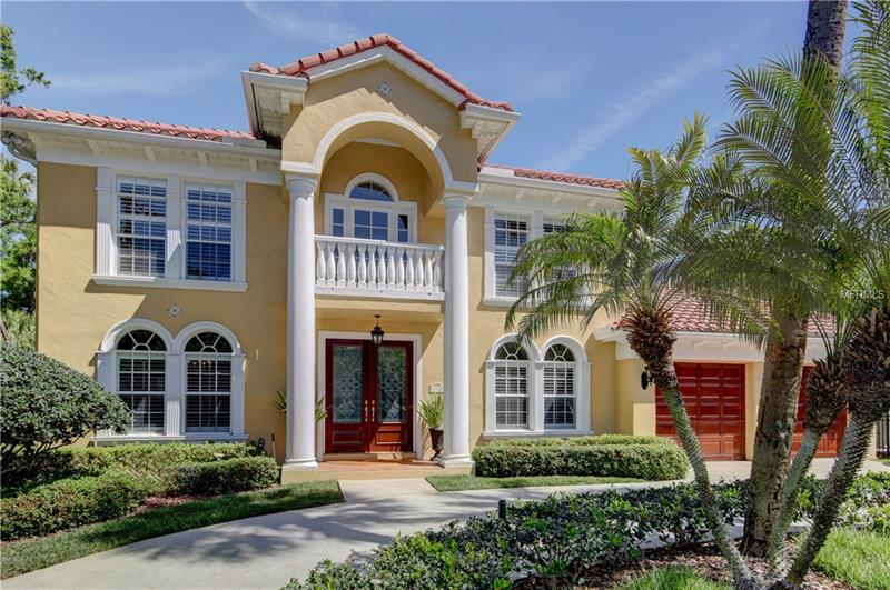 This meticulous mediterranean style home offers 3,291 sq. ft. , 4 Bedrooms / 3 1/2 Bathrooms, spacious 9'' 4'  ceilings, natural finish oak wood floors, unique two way oak staircase, plantation shutters, crown molding and trim throughout, wood front entry door system, and energy efficient block construction!. The first floor features the family room, kitchen, formal dining room, living room, half bath, and a den/bonus room.  The family room/kitchen (including a breakfast nook overlooking the backyard) combination is a wonderful space to enjoy gatherings and flows naturally to the outdoor space where you will find a covered lanai overlooking the pool and backyard. Upstairs you will find a large master suite including master bath offering dual sinks, whirlpool tub, separate glass enclosed shower, linen closet, and his and hers walk in closets! A guest room with a private bath as well as two additional bedrooms sharing the third bathroom create an upstairs space that is adaptable to the many changing needs of most families. Additional touches include laundry room complete with laundry chute, wood burning fireplace, recessed lighting, intercom/music system, professional landscaping, circular driveway, and endless amounts of storage space. This home is a must see!!