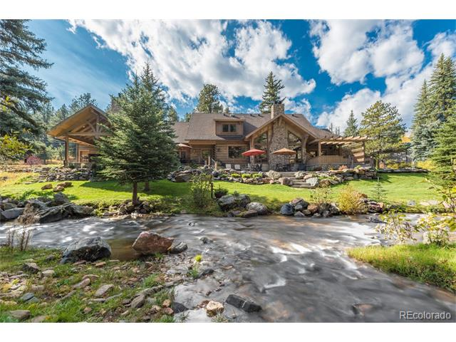 Just minutes from downtown Evergreen, this hard-to-find newer construction on Upper Bear Creek offers luxurious Colorado living. Relax or entertain on your private outdoor veranda. Enjoy a soak in the hot tub or a crackling fire in the outdoor stone fireplace as you absorb the beauty of the mountains and tranquil sounds of the creek. The gourmet kitchen is a cook's dream with high end appliances and is open to the great room with timber beams and a floor-to-ceiling stone fireplace. A superbly crafted wine room will delight any wine connoisseur.  The Master Suite is a spa retreat boasting slate tile, copper bathtub, and steam shower.  A private outdoor patio area and hot tub access off the Master Suite make for romantic evenings.  Three large bedrooms, each with walk in closets, offer space for family and friends.  A whole house sound system, over-sized three car garage, and attention to every detail make this custom mountain home by J Anthony Design simply spectacular.
