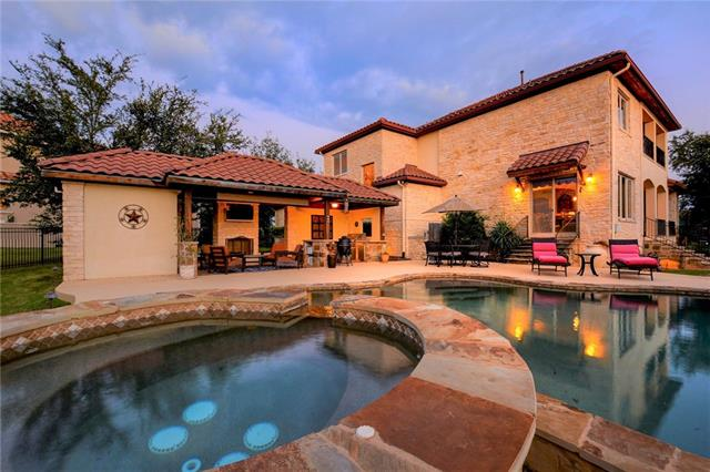 Enjoy resort-style living in this custom-built Randy Rollo home located within the gates of the UT Golf Club in Steiner Ranch! This home sits on 1/2 acre cul-de-sac backing to greenbelt w/panoramic hill country views! Backyard oasis w/pool & spa, & cabana w/built-in grill & fireplace! Finest quality workmanship w/custom details throughout, fresh paint, & multiple living spaces! Master & guest suites on main, huge game room up & 2nd story balcony w/spectacular views! **Seller offers $20K flooring credit!**