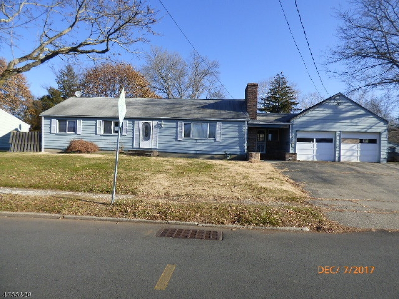 What a buy. Nice ranch with large 2 car attached garage on a level corner lot. Large rooms, family room with wood burning stone fireplace. Both bedrooms are nice size. Master with ensuite. Gas Forced Hot air heat with central air.  Large kitchen with separate dining area and formal dining room.