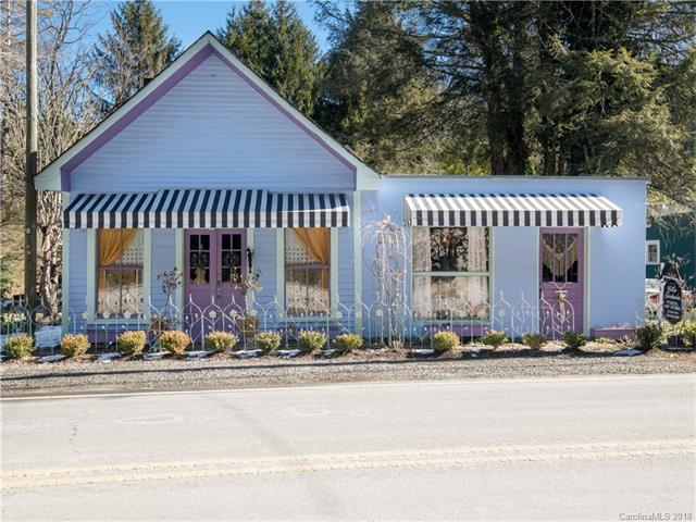 Remember that dream you've always had to find the perfect live/work option? We found it for you! Calling all artists, cafe dreamers, clothing enthusiasts, book lovers, creative bakers and entrepreneurs - there are so many opportunities just waiting to blossom in this quaint and spirited remodeled home/business. This was Flat Rock's original post office built circa 1834, rich with history, including Carl Sandburg's presence mailing his manuscripts, reading poetry & playing music. Throughout an extensive and impressive remodel, the owner maintained the integrity of the building's original character, especially evidenced by hardwood floors that seem to tell their own beautiful stories. Improvements include new heat&air/plumbing/electric, stove, carpet, insulation, Etowah fireplace & more. Warranties exist on major appliances. This community token is an ideal storefront opportunity in promising Historic Flat Rock! Certificate of Nonconforming Use on file. Contents available separately.