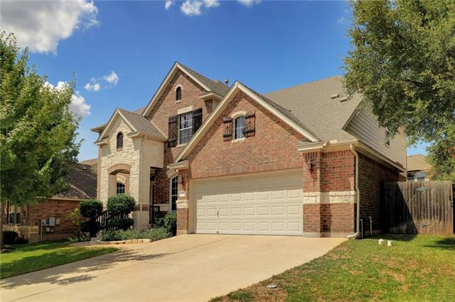 Highly sought after Ranch at Brushy Creek - Well-appointed 2-story brick/stone home on lushly landscaped lot. MANY updates since owners have lived here. Open floor plan concept for entertaining. Hardwood laminate floors down, granite counters, newer appliances in kitchen, high-ceilings, updated fixtures, designer paint, new backsplash/fireplace tile, devoted office, master bedroom down. Media/music room, game room, 3 beds/2 baths up.