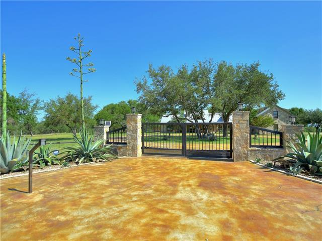 Unrestricted gated 54.7 Ac well maintained get-a-way retreat/gentleman's ranch. Captivating hill country & sunset Views! Upscale remodeled home w/ 3 bedrooms 3.5 baths plus over the garage flex room/bunk room/game room/man cave with full bath. Log cabin guest house w/ fireplace, kitchen, full bath. Drive thru Barn/Shop. Many more amenities & features! Ideal location just outside Johnson City convenient to Fredricksburg, wineries, Horseshoe Bay, Blanco. Easy drive to major airports in Austin & San Antonio.