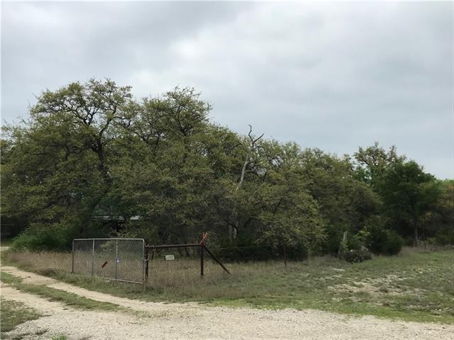Well treed 4.42 acres. No deed restrictions! Could be storage business, RV park, shared family compound, Commercial shop, etc...Electricity on property and a Well + Septic w/ building. Well and septic are not functioning. Building could be renovated to be living quarters or office. Lots of possibilities...Buyer to verify.