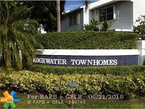 Located on the outskirts of Wilton Manors this 2 bedroom/1.5 Bath is located in a quiet gated community.  The unit has tile and wood floor through out, washer/dryer, updated kitchen and bathrooms.  Walk out the back door to the pool area.  This property is located minutes away from major highways, shops and the beach.