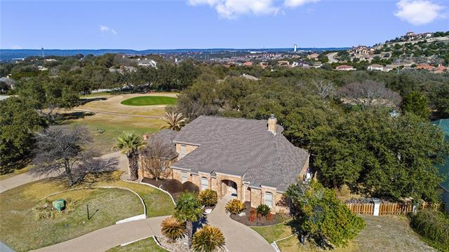 Stunning golf course home on Yaupon GC with a pool! This updated home sits on 2 lots and is protected from anyone building to the left where the 5th hole is. Tranquil back entertaining area looking over the green, arbored deck with mature oaks providing an awesome place to relax and enjoy! Tons of updates, New Floors, Roof,  interior rock work, updated kitchen, baths, shower, and much more! The owners of this home have truly taken care of it and it shows. The layout of this home is amazing!