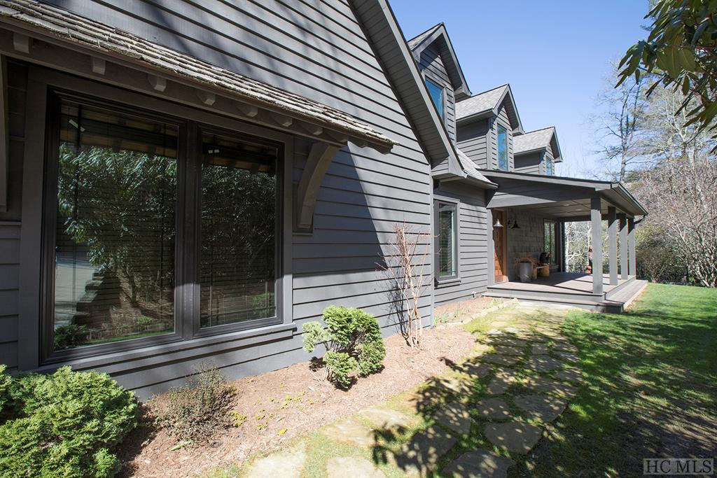 """The Shining Light on the Hill""  This Custom-Built Mirror Lake Masterpiece has room for all!  The 5-bedroom layout ""lives large"", but feels like a small cottage thanks to a creative design and build.  The open main floor living includes floor-to-ceiling custom accordion doors which bring an over-sized outside deck to life, entertainment, and gatherings with family, friends, in-laws, and out-laws!  A double garage, walkways to both decks, a front porch perfect for reading a book, garden terraces, and custom landscaping say ""welcome home"" on the outside.  Inside, top-shelf Chef's Kitchen, high-end appliances, plenty of counter space and eating areas create the perfect party place.  A expansive lower level boasts a media/living room, secured wine cellar, adjacent wet bar, all of which opens to a second deck replete with a custom stone outdoor fireplace.  The Bunk Room room on the lower level sleeps a crowd and completes the entire experience.  There's nothing quite like the town of Highlands, which invites you in just a short distance away.  Hike, Bike, Fly Fish, Shop, Paddle, Birdwatch, Concerts, Plays, Art, Eat, Drink, and be Merry."