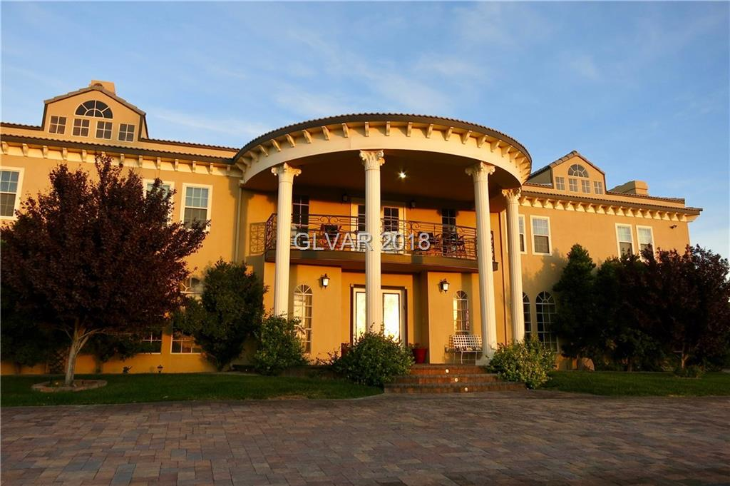 Beautiful custom mansion on 3/4 acre lot boasts million-dollar sweeping views of Strip/mountains/Downtown from every room and balcony. Main home includes private theater, walk in wine cellar, billiards room, separate living and dining rooms, bar area, and gracious double staircase entry. Gorgeous pool, large spa, circular driveway, fruit trees, putting green, rose garden, fire pit and a half basketball court. Available furnished/unfurnished.