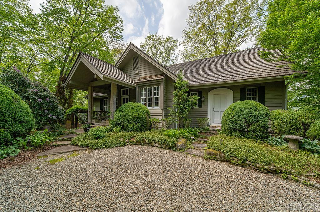 This home offers a quaint setting inside the gates of the exclusive Chattooga Club. Five bedrooms and five baths provide plenty of room for guests. Located at the end of a quiet street with plenty of privacy, beautiful landscaping with indigenous plants surrounds the home.  The main level has two bedrooms, two baths and a grand living room with a gas fireplace. A covered deck with wood-burning fireplace boasts spectacular views of Chimneytop, Bald Rock, Hogback, Big Sheepcliff, Little Sheepcliff,  Shortoff, and Yellow Mountains. The upper level has two bedrooms, two baths, and a loft that could be used as a home office. The lower level consists of a large great room with full-sized wet bar and wine cellar, one bedroom and bath, a wood-burning fireplace plus an adjoining covered deck. Beautiful heart pine floors are throughout the whole house.  The property is only a short walk to the Club and all amenities, including a picnic area overlooking Mac's View and Lake Chattooga, which is stocked yearly for trout fishing. The owner has taken wonderful care of this very special home.  Membership to The Chattooga Club is by invitation only.