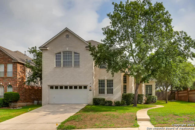 Fantastic home with tons of space to suit your needs!  This beautiful 5 bedroom, 3 bath home features a dramatic entryway, wood floors, fireplace, an island kitchen with breakfast nook, and a lush green backyard that's fenced for privacy. Fifth bedroom can be used as a study. Smooth cooktop. Dishwasher. Ceiling fans throughout. Crown molding. Huge walk-in closets. Master bath features separate tub and stall shower and a vanity that goes on for ever! This home is ready for immediate move-in!