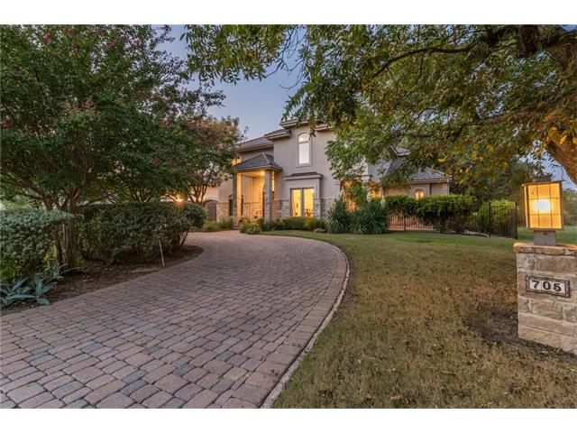 This one-owner custom home is a treasure. With backyard views of Pecan Creek and the nature that abounds, enjoy the heated pool and hot tub or enjoy a meal on the covered patio or sip wine on a cool evening by the stone fire pit. Propane fuels the kitchen cook top and office fireplace. The living room fireplace is wood burning with the propane fire starter.  Pecan Creek has a perpetual waiver to the Resort at Horseshoe Bay upon acceptance and approval. Currently a $25,000 value