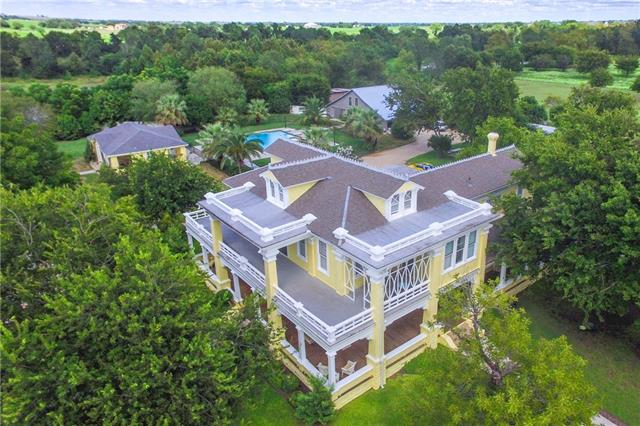 Phenomenal opportunity to own a piece of historic Taylor. Property consists of historic mansion(4442 sqft),modern barn home(1886 sqft),event space w/commercial kitchen&baths(5804 sqft).A wrap around porch overlooks the impeccable property complete with a pool & hot tub. An incredible 2 acre pond surrounded by mature oaks adds privacy to this iconic estate. Currently operating as an event venue, income potential unlimited. Adjacent pasture also used for hay production. Addtl. acreage options available.