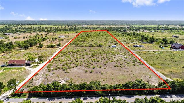 Build your dream home and ranch on this beautiful 10 acre lot!  Completely cleared out and level.  This is a blank canvas for you to build your masterpiece!  Qualifies for agricultural exemption.  Dimension are approximately: 340 feet wide x 1,290 ft. deep. Low taxes.  Quick access to 290, I-30 toll, ABIA, and downtown Austin. Water lines extended into the lot. No deed restrictions.