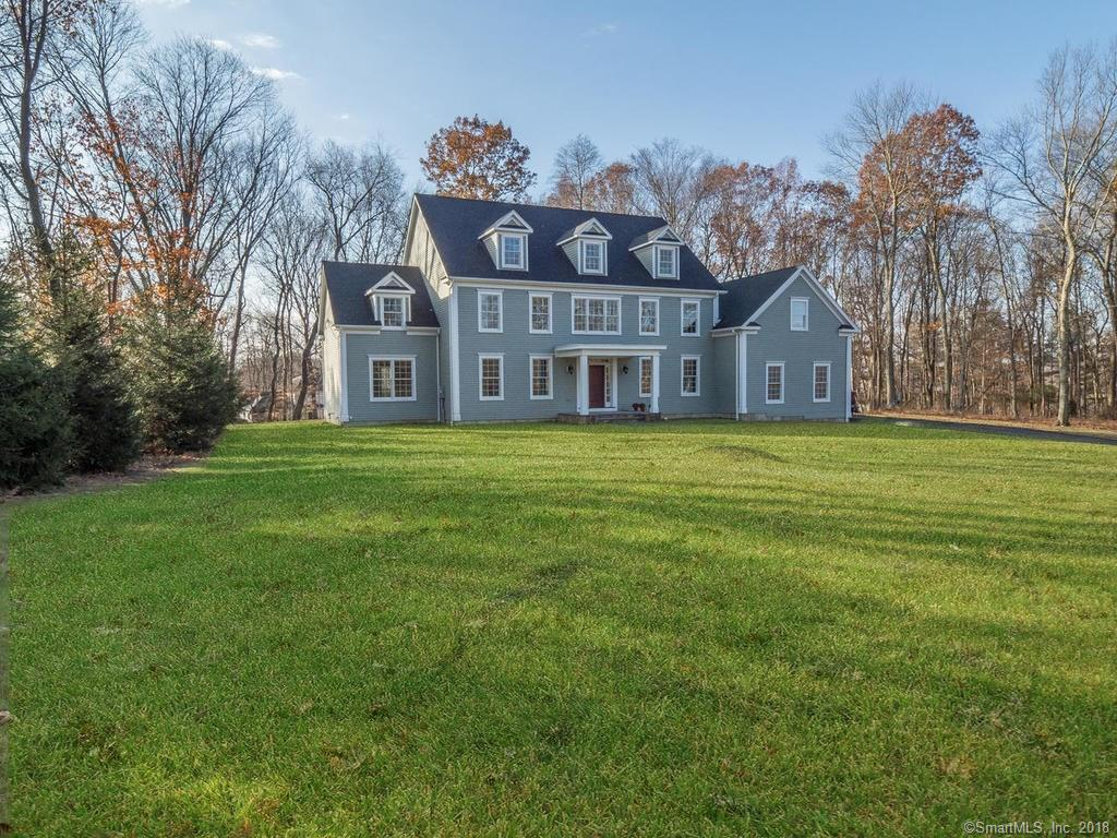 COMPLETED JANUARY 2018 - Elegant new construction in South Wilton. A charming 11 room colonial, 4700 +/- sq. ft. set back from the main road with it's own private driveway. The floor plan offers a first floor en suite guest bedroom and an easy flow for entertaining including a large kitchen with Kingswood cabinets and Quartz counters with a large island and separate eating area overlooking the back yard with patio; a family room with fireplace in addition to a formal DR and LR on either side of the impressive two story foyer; a small office and powder room and a mudroom with entry from the 3 car garage. The 2nd flr. offers an en suite Master Bedroom with large sitting room, full custom bath and walk-in closet, 2 additional en suite bedrooms and one additional MBR with walk in closet and full bath, which can also be used as a bonus room.  The large back yard with patio on 2 acres completes the package with room for a pool.  Unfinished, walk out basement can be finished at an additional cost. Basement already plumbed for bathroom and wood burning stove.  Call LA for further info. Very close to schools, town, highways and 1 +/- mile to train at Cannon Crossing with easy parking.
