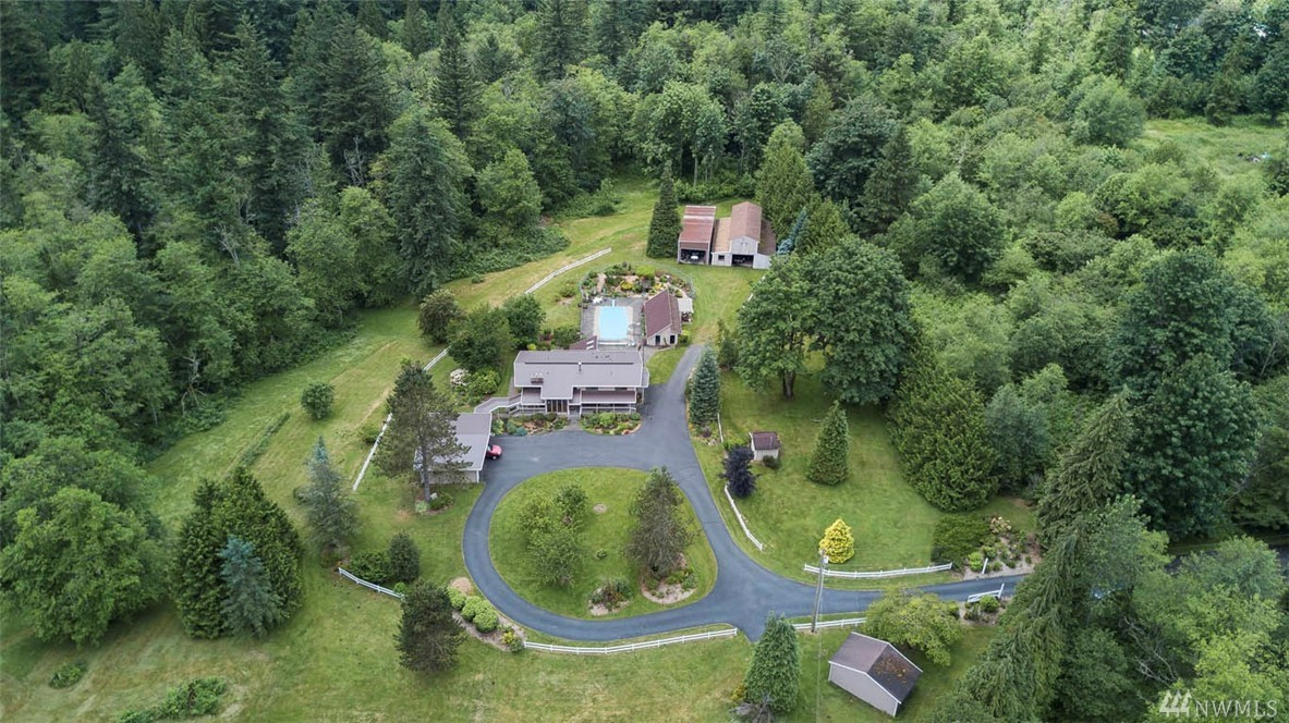 Hobart Hobby Farm! Spectacular 13+ acres on 3 lots. Spacious 5bdrm home w/stunning light filled entry & 2nd kitchen downstrs. Unique amenities incl 32' in ground pool, sport court, spa room, pool hse, potting shed, huge barn & additional shop. Fenced garden walk w/waterfall & Koi pond. Breeze way to 3 car garage w/covered RV parking. Manicured acre & gorgeous un-cleared remainder w/tax deferred benefits for buyer. Close to HYW 18, Maple Valley, Issaquah & Renton. Top Rated Tahoma Schools.