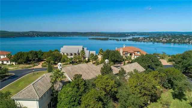 STRIKING custom home on prominent corner lot in Lakeway's premier, gated community of WATER FRONT. Thoughtfully designed split-level floor plan with SOARING VIEWS of Lake Travis and the Hill Country from nearly every room! Walk to the water, BOAT SLIP available one street away at MARINA! RESORT-STYLE pool and spa with large, flat back yard. Media Room, Exercise/Playroom, Game Room, large Bedrooms, Formal Living/Dining, and a stunning Master Suite! Low tax rate! 2/3 acre, LOW TAX rate, AMAZING price/sf!