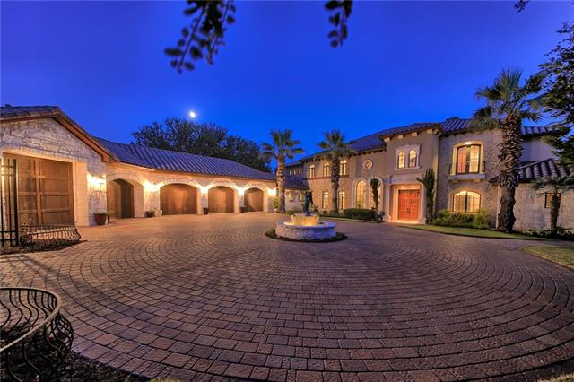 Elegance abounds in this spectacular home on 3.69 acres with stairs to waterfront of Lake Travis. The Amazing views from all 3 levels of this home will take your breath away! And so will the 5 car garage, negative edge pool, fire pit and private stream with multiple waterfalls going down to the lake. PLEASE allow 24 hour notice to show, agent must be present for all showings. Features list, Disclosures, floor plans and copy of survey available in documents.