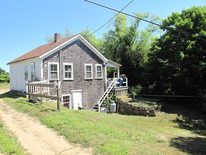 """Wonderful opportunity for a buyer with carpentry skills to own a piece of Block Island.  Nicely located near the town, school and Medical Center.  Walk to town and the Mohegan Bluffs. Nice views over Conservancy land.  Small shed on property.  Sold """"as is"""""""