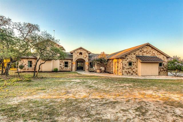 INCREDIBLE OPPORTUNITY TO OWN A STUNNING, ONE STORY, CUSTOM HOME ON OVER 14 AG-EXEMPT ACRES WITH CONVENIENT ACCESS TO HWY 183! The home sits on a hill surrounded by mature oaks overlooking beautiful Hill Country views. Custom features include: granite countertops throughout, walk-in master shower, outdoor living area, ultra energy efficiency, and fun additions like a PEDICURE SINK, LOFTS IN THE KIDS BEDROOMS, AND A HIDDEN BOOKSHELF DOOR! Perfect mix of serenity and close access to nearby shopping!