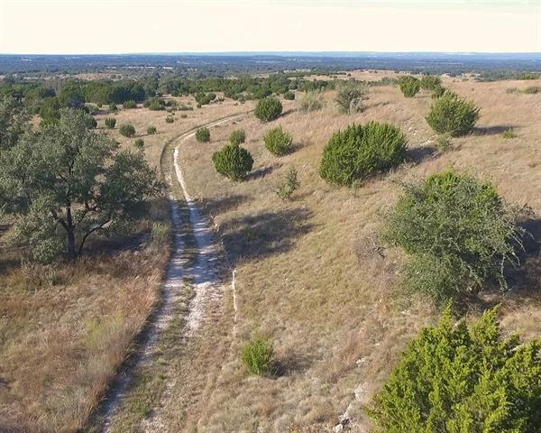 Beautiful 100 acre piece of land located in Spicewood! Conveniently located near Hwy 71 and 281. Follow the long paved roadway that leads to the entrance. The property currently has a wildlife exemption. Each lot requires well and septic. Electricity is available. Over 200+ feet of elevation changes from the front of the property to the back. Dramatic views for miles on top of the highest point. Currently has a wildlife exemption. Property can not be subdivided less than 25 acres.