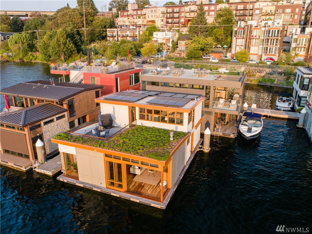 Welcome to this end-of-dock masterpiece located in Seattle's premier floating home community of Wards Cove. Ideally located to take in sweeping 180 degree views of Lake Union, including downtown, ship canal & Gas Works Park. Enjoy spectacular sunsets, water action & fireworks. This showpiece home was built specifically for this site, mindful to take in & reflect the surrounding nature & views. Features include custom woodwork, cherry floors, solar systems, green roof, wine room & smart parking.
