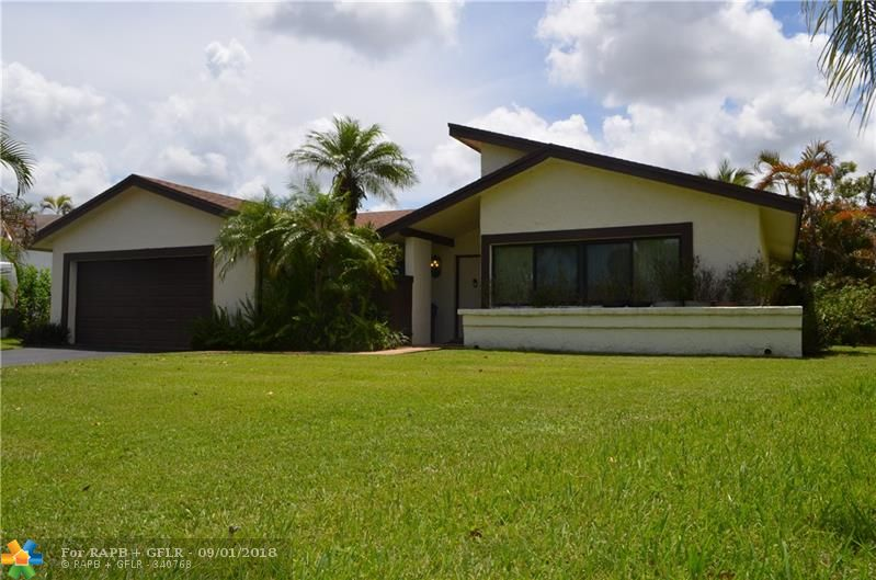 Beautiful 3/2 home in Welleby. Sitting on a 15,206 square foot lot. This home features an enormous backyard with a pool,impact windows, recently installed laminate floors, vaulted ceilings, freshly painted and ready to move in. A must see!
