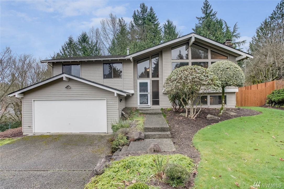 Beautifully remodeled Fairwood Greens home sits on 1/4 acre manicured culdesac lot. Livrm w/vaulted ceiling w/floor-ceiling windows, fireplace. Kit w/granite, SS appls, custom cabs, open breakfast bar to dining rm. Fantastic flooring. 3 bedrooms + TWO bonus rooms. 3 bedrooms-master w/ensuite bath w/granite & tile. Cozy fam rm w/stone fireplace & spacious enough for furniture & game rm, wet bar. Gorgeous, secluded yard w/multi level deck, patio, shed, fenced. Pre-inspected for your convenience!