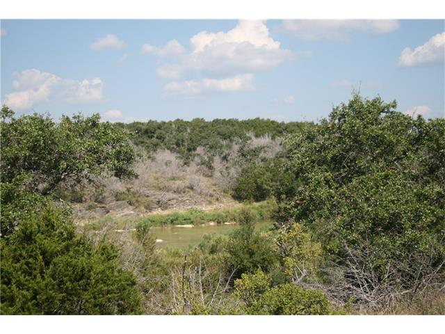 Rare Pedernales  river frontage in excess of 1000 ft.  Secluded land.  Hill top building site with great views.  Currently ag exempt. Be sure to use Arial view to see property.  Better photos later.  SHOWN BY APPOINTMENT ONLY WITH AGENTS. Surrounded by larger tracts.  Land is subject to survey. Will  besold as more or less, will be sold by # of acres