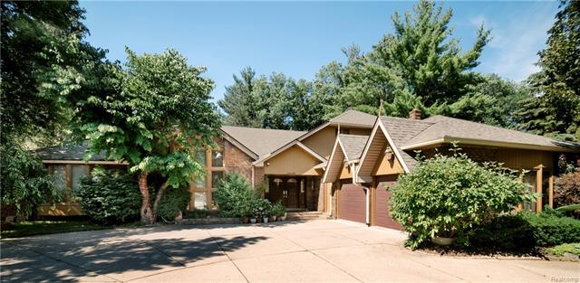 Spectacular Custom 6+ BR, 6.5 Bath. Large Family Home Built by Benivegna (original owner).  Room for everybody. In Law Suite/Nanny Suite, too!  Double French beveled glass drs. opens into huge GR w/stone fireplace, soaring ceilings & doorwall to deck overlooking privately landscaped/wooded yard. Formal DR w/gorgeous crystal chandelier imported from Italy, custom imported crown molding & electronically operated drapery.  Lrg. kitchen, tiled island w/instant hot & cold water, walk in pantry, vaulted ceiling, built in glass cabinet. 1st Flr Laundry. 1st Flr MBR Suite w/imported crown molding, large bath w/jetted tub & walk in closet.  Upper Loft, 3 Bedrooms & full bath.  Custom finished LL WO features brick FP, full kitchen w/dining area & nook, huge fam rm, rec room, wine room, exercise rm, dance floor, spa/sauna, 2 full baths & doorwalls to patios, great for summer BBQ's. Central Vac system.  Circle Drive w/courtyard entry garage.  Priced at only $115 sf.  A ton of house for the money.