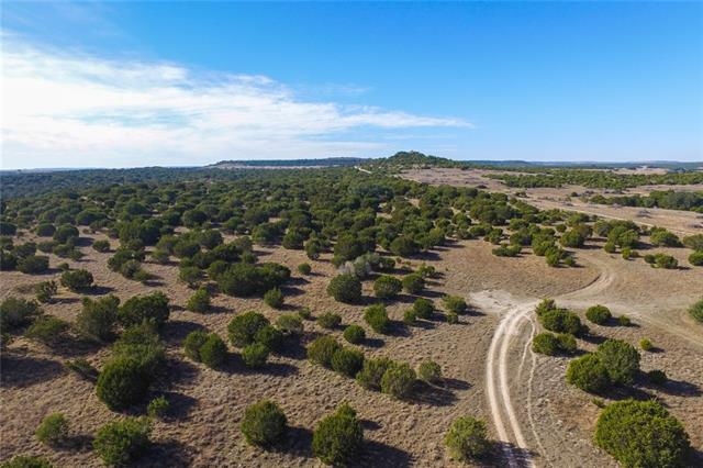 This magnificent hunting/recreational ranch. The varied topography has over 150 feet of elevation change and offers big views from several locations. There is excellent game cover, consisting of oak, elm, mesquite, cedar, and huge sycamores along the creek. Surface water consists of an intermittent creek and two ponds. There is a community water line on the county road and the land is ag exempt. The Seller will divide or if you need more acreage, there is adjoining land available.