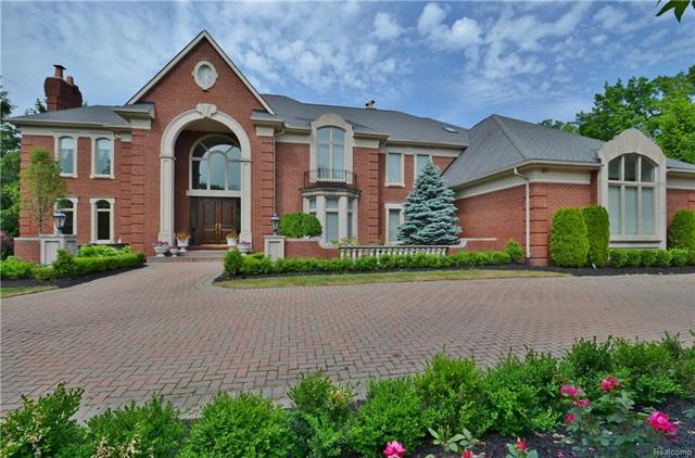 Gracious home nestled in the serene and gated community of Heronwoods.  The property's beautiful interior comprises more than 10,500 sq. ft of show stopping luxury with vast living spaces & exquisite details throughout. Grand foyer offers guests a spectacular welcome while high ceilings and beautiful marble and gleaming hardwood floors grace flexible entertaining spaces which include chef's kitchen with granite, custom cabinetry & superior appliances as well as a magnificent living room and great room. Walls of windows infuse the entire house with light & allow for stunning views of the lush grounds with swimming pool overlooking wooded ravine & pond. Luxurious master suite is a true oasis with sitting room, dual bathrooms, walk-in closets and separate vanity area.  The upper level showcases 4 additional bedrooms & 3 bathrooms. LL boasts kitchen, 2 full bathrooms, sauna, family room, bedroom, workout room & walks out to patio. An unparalleled estate in private and peaceful location!
