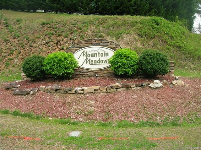 Phase III Mountain Meadows. Great views, stream, open areas, stick built or off-frame modular. 1600 sq. ft. minimum with 2-car garage required. Common area with small waterfall, picnic area, foot bridge and stream. Enjoy watching the wild turkeys and deer. Minutes to town. Paved streets, underground utilities. Gentle topography. See attachments for more info.
