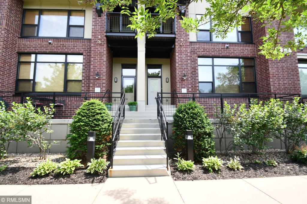 Beautiful urban townhome at Upper Landing on Mississippi River, steps away from Downtown St. Paul with 23 miles of trails outside your home. Inviting front porch, open flr plan, high ceilings, oversized windows, gas fplc w/built-ins, surround sound, chef's kitchen w/walk-in pantry, island, accent lights, powder rm, & private, heated 2 car garage w/storage. 2nd level: large master w/walk-in closet, bluff & downtown views from balcony, 2nd bdrm, luxury bath w/sep wp tub & shower, laundry & loft.