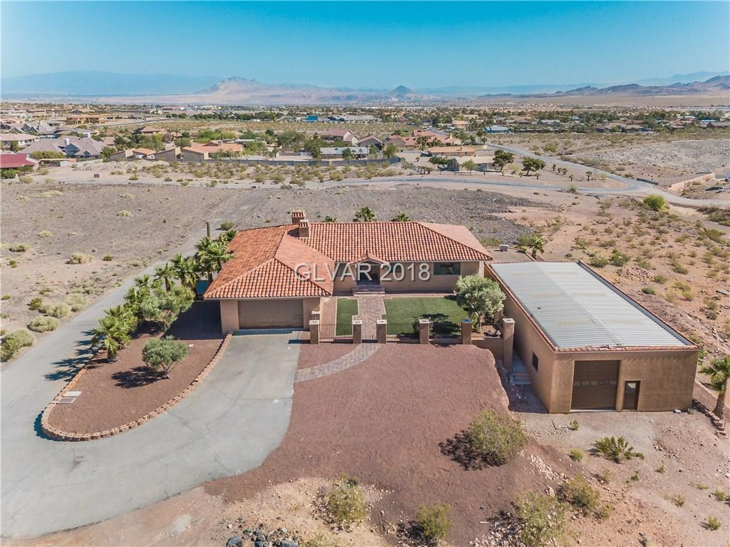 COMPLETELY REMODELED CUSTOM HOME WITH 360 DEGREE CITY/MOUNTAIN VIEWS ON 1.39 ACRES & UNBELIEVABLE SOUTH HENDERSON LOCATION! WRAP AROUND BALCONY, HUGE 30X60 RV BARN/GARAGE & 14 W/ 14 FOOT CEILINGS, NEW QUARTZ COUNTERS, BUILT-IN STAINLESS STEEL APPLIANCES, NEW WATER RESISTANT LAMINATE WOOD FLOORING, NEW PLUSH CARPET, NEW LIGHTING & PLUMBING FIXTURES, NEW UPGRADED BASEBOARDS, NEW DOORS & HARDWARE AND NEW INTERIOR & EXTERIOR PAINT. NO HOA FEES HERE!