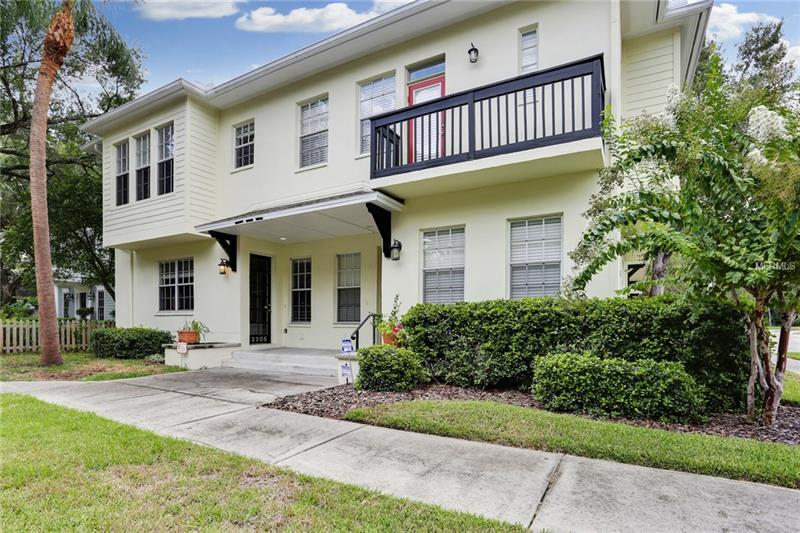 Charming South Tampa Townhome located in New Suburb Beautiful has been beautifully updated.  This 2 story unit is ready for an elevator & features wood floors in the downstairs and upstairs living room and dining room. 10' ceilings on each floor and plenty of natural light throughout.  The first floor has a full bathroom and bedroom/or living room space.  The wood stairs case leads to the Master bedroom with soaking tub and large walk-in shower and walk-in master closet.  A second bedroom with it's own bathroom and plenty of closet space.  The main living room and dining room are open along with the kitchen for an open family living style.  The cherry wood cabinets, stainless appliances and gas stove cooking is perfect for a chef.  The extra large 2 car garage has plenty of storage.  A side garage door leads to a fenced run along the house perfect for a pet.  NO HOA FEES.  The building is well maintained.  A fabulous location to all of SOHO restaurants & shops, Hyde Park, Bayshore Blvd, CineBistro Movie Theatre.  This gorgeous family neighborhood is perfect for walking under the old oak trees.
