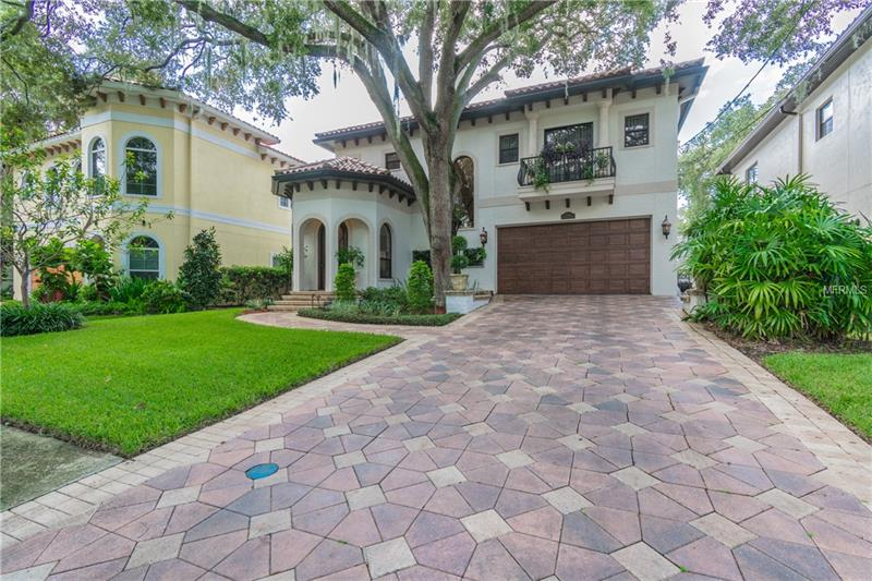 Magnificent Mediterranean pool home in the Bayshore Beautiful neighborhood is just over a block from the coveted Bayshore Boulevard and is surrounded by new construction. Grand entryway welcomes you with marble floors and artistic hand-painted, high ceilings. The living room boasts rich dark hardwood floors, built-in bookshelves and cabinetry, as well as a gas fireplace. Step down into your oversized formal dining room that is sure to impress your finest dinner party guests. High arched windows overlook a very chic contemporary pool with spa jets and underwater lighting options. Outdoor kitchen for poolside entertaining. Huge chef gourmet dream kitchen with no expense spared. Stainless steel Sub-Zero & Wolf appliances, granite countertops, breakfast bar, travertine floors, wine refrigerator, warming drawer, and impressive center island. All hardwood floors lead you upstairs where you will find a spacious master bedroom suite with balcony and luxurious master bath featuring Carrara white marble throughout, dual sinks, large jet bathtub and a separate walk-in shower. Walk-in closet has custom cherrywood cabinetry. Second bedroom has walk-in closet and en-suite bathroom. Third and fourth bedrooms have access to back balcony. Home is two-story, all block construction with tankless water heater, water purifier, barrel tile roof, entire house wired audio-visual system, alarm system, gas exterior light fixtures, 10 ft high ceilings, crown molding & 7.5 inch baseboards throughout. NO Flood insurance required.