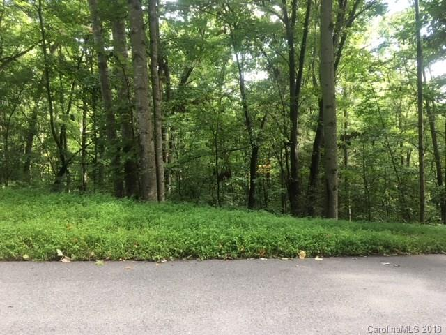 Beautiful Park Knoll in Etowah - 1.4 wooded acre lot - you can build with a minimum of 1100 sqft - city water - covenants, paved private road - only $13250!! Modulars are ok! No Manufactured Homes.