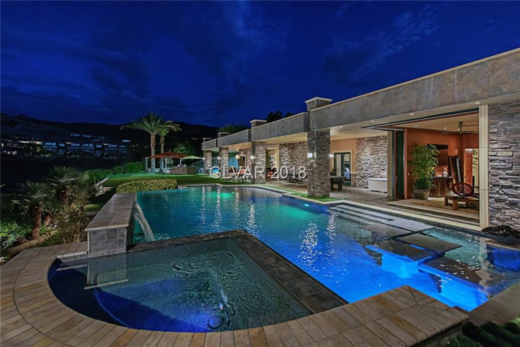 BEYOND INCREDIBLE! 6,563sf single story home w/add'l 2,448sf basement. Enormous master w/his&her custom closets, amazing bathroom lrg round jacuzzi tub, oversized SteamMist shower. Spectacular gourmet kitch w/granite, 4 ovens, 2 dishwashers, custom cabinets, Moen prep sink, Meile in-wall nespresso, sub zero, warming drawer. Great rm w/1200 gallon salt water aquarium.  pocket doors w/Linear air diffusion mingle stunning interior w/magnificent