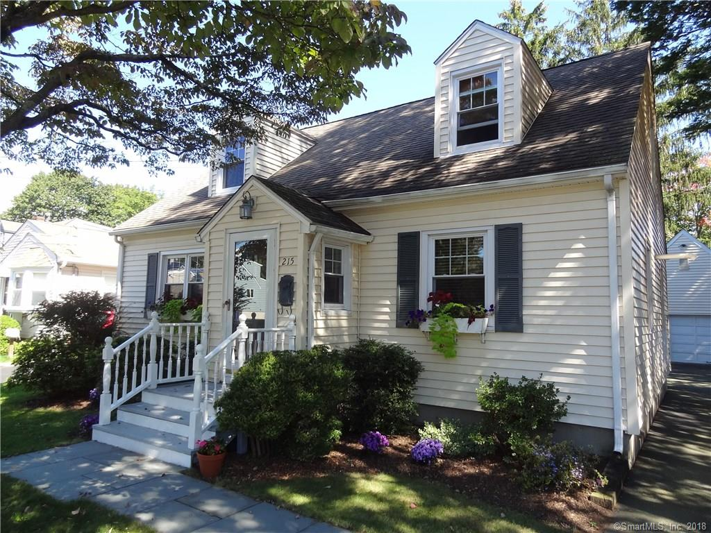 Enjoy walking to shopping, restaurants and the train from this great in town expanded Cape Cod located on a quiet tree lined street in the beach area.  This four bedroom, two full bath home offers an open kitchen/family/dining area that is ideal for entertaining and a main level bedroom and full bathroom.  The home has an updated kitchen with stainless appliances, an updated bathroom, newer windows, vinyl siding and most recently a new gas heating system.  The second level has three bedrooms and a full bathroom and there is an oversized garage with a loft and a wood deck.