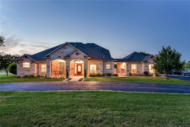 Gentleman's Ranch boasting breathtaking views of rolling fields & ponds on 78.4 acres while longhorns graze in the distance. Main house offers a Gourmet Kitchen, Bright & Open living w/ stone fireplace, Secluded master retreat w/luxurious ensuite ideal for rest & relaxation. Private media rm, game rm w/wet bar upstairs & a private balcony to enjoy a cold drink & soak in sunset views. Guesthouse is attached by a breezeway & boasts a kitchenette, hardwood floors, handicap accessible shower & large closet