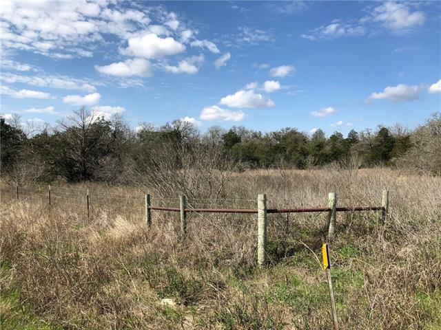 Heavily wooded acreage with road frontage on two County maintained roads - Gotier Trace and Old Pin Oak Road. Water features include a pond and a creek located on the back side of the property. Minerals will convey. Please wear appropriate clothing when viewing ~ recommend jeans and boots.