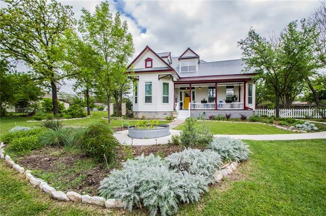 Beautifully updated historic century house in the heart of Hutto.  Contains Victorian charm and modern amenities in a recently renovated kitchen with a refurbished antique desk as the island.  Perfect house for entertaining with two porches and large deck.  Gorgeous native landscaping on a corner lot.  New Detached garage with workshop.  Walking distance to Downtown Hutto and Fritz Park.
