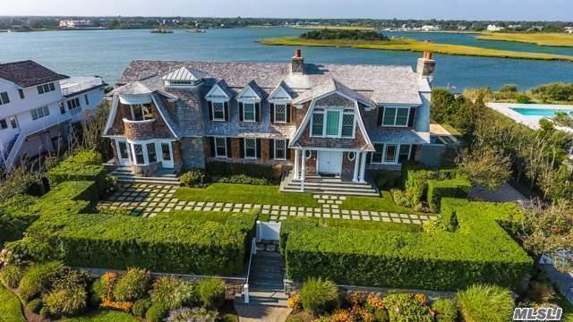 Stunning 6,200Sf Traditional Set Between The Bridges On Dune Road W/ Water Views From Every Room. The Expansive Floor Plan Offers Living Rm W/Fplc, Chef's Eik, Butler's Pantry, Formal Dr, Theater, Study, Office, 2 Master Suites W/Spa Baths/Showers, 4 Guest En Suites & Gym. Expansive Terrace W/Heated Gunite Pool, Spill Over Hot Tub & Waterfall. Private Dock & Ocean Access.