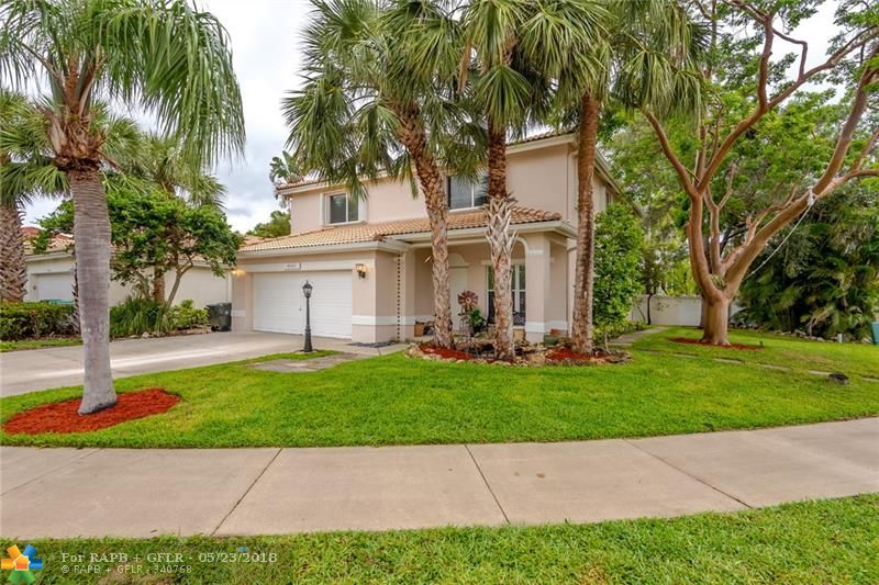 *Stunning & unique home on corner lot!! 4 bedrooms on the 2nd floor w/high end laminate flooring. Modern Farm-style accents.. Shiplap, farm style light fixtures, open floating shelves in Kitchen*Tile floors throughout downstairs. Updated newer kitchen w/new SS appliances, granite counter tops, glass tile back splash, eat in area +snack bar* Upgraded bathrooms*large Covered patio has high ceilings and sky lights. Accordion shutters. Amazing schools/Low HOA fee w/ lawn service, gated entry, community pool**