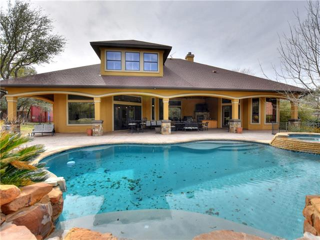 This stunning house sits on a huge, open lot with many interior and exterior features. Once you enter the home, you are greeted with high ceilings and beautiful finishings throughout. Perfect for entertaining family and friends. The inside is very spacious and allows a lot of natural light in due to the large windows. The backyard has a magnificent pool area including a hot tub and a patio. Close proximity to water access and marina.