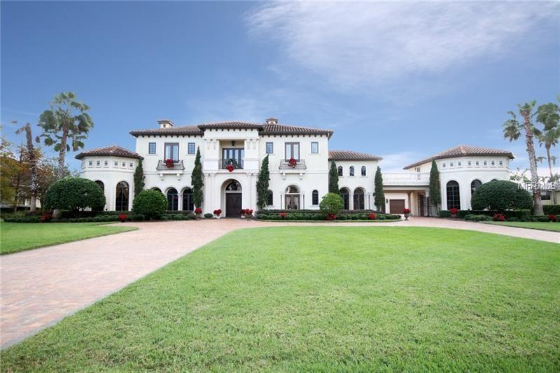 Spectacular castle-like Mediterranean Villa graced with Roman Moroccan Architecture, detailed stone work, wrought iron and amazing woodwork throughout the home. This magnificent work of art is built for entertaining. Precise attention to detail throughout. The downstairs level of this Grand Villa has 2 master suites, a Jr. Suite Executive office, family/game room with custom bar, large formal dining and living rooms are divided by a dual stone fireplace. The large gourmet kitchen is a chefs delight that can fit a table for 12. Includes a large walk-in pantry, wine room and huge laundry room. Outdoor summer kitchen/lanai with view of estate designed pool. Second story has large gym, family, game and music rooms, unfinished theater room, 3 large bedrooms w/own baths, walk-in closets and second laundry room. Relax on the sunbathing terrace overlooking the beautifully manicured 1 acre yard. Plenty of storage space available. (Some furniture optional for purchase. Owner may consider seller financing.)
