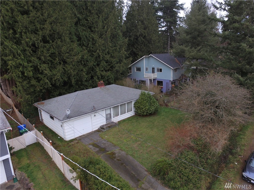 Cosmetic fixer-flipper, best value in Shoreline! This diamond in the rough is ready for your immediate equity upgrade!  Add carpet & paint, update kitchen & bath to make this home shine!  Great bones, and large lot backs up to Northcrest Park.  Huge backyard is cedar treed filled which could provide value.  Close to all conveniences and coming soon Sound Transit Portals!