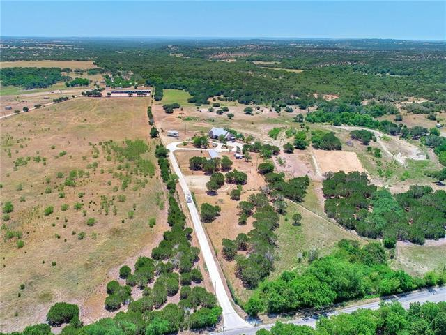 Ag Exempt! No city or deed restrictions! Gorgeous panoramic hill country views! Over 58 acres in a prime Dripping Springs location w/easy access to Hwy 290-Live the hill country life w/the luxury of amenities nearby! One story ranch style farmhouse w/2,864 square feet (Per Tax Records), bonus room/den/study, sparkling pool & spa, covered patio, commercial greenhouse, stable/tack, carport/equipment shed, 40,000 gal rainwater tank, gazebo, intermittent pond, fully fenced & gated. Buyer to verify all info